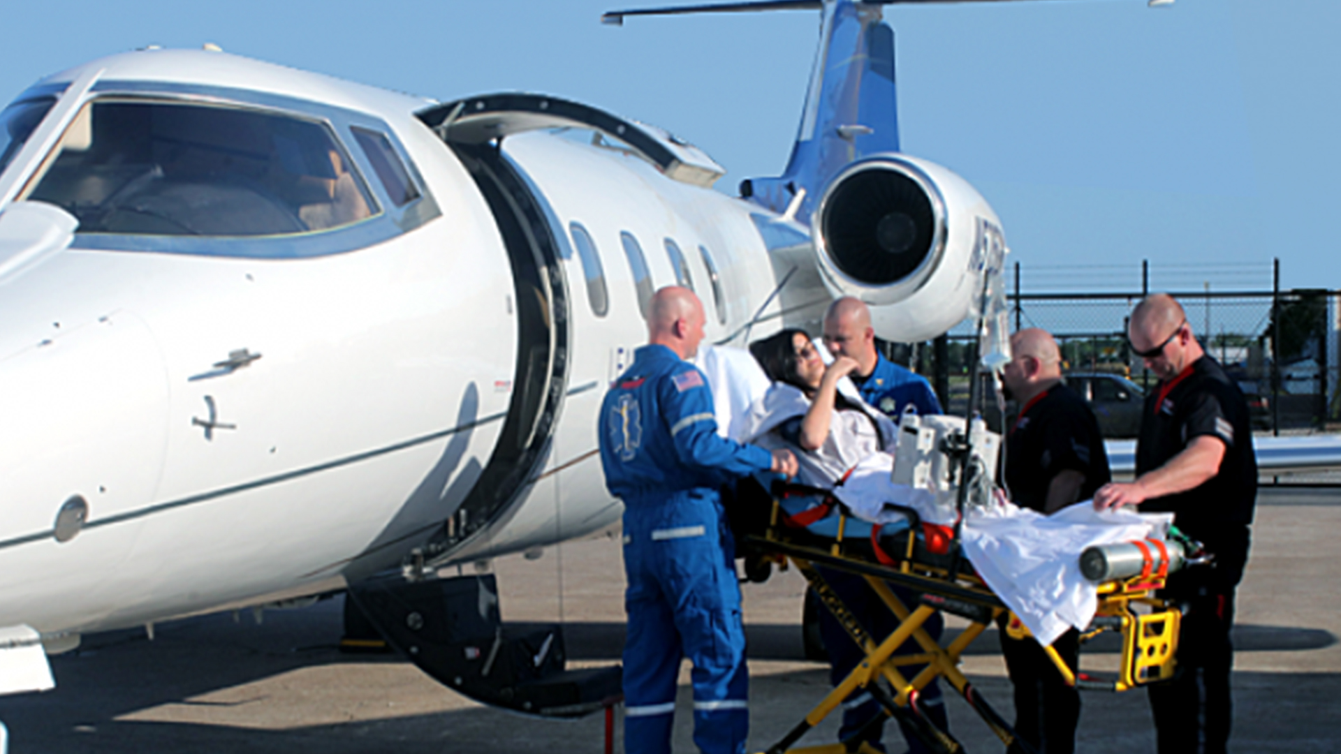 patient carried into air ambulance aircraft by medical team