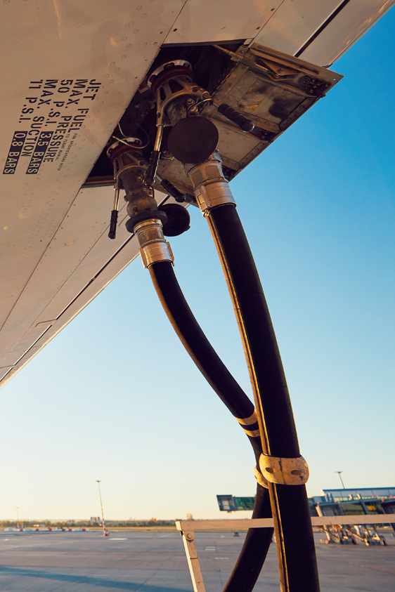 Aircraft is refueling under wing in airport