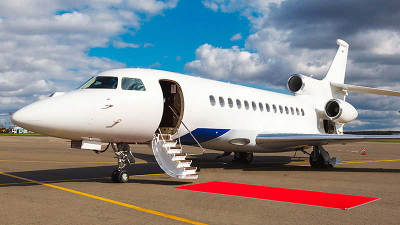 private charter aircraft with red carbet awaiting passengers