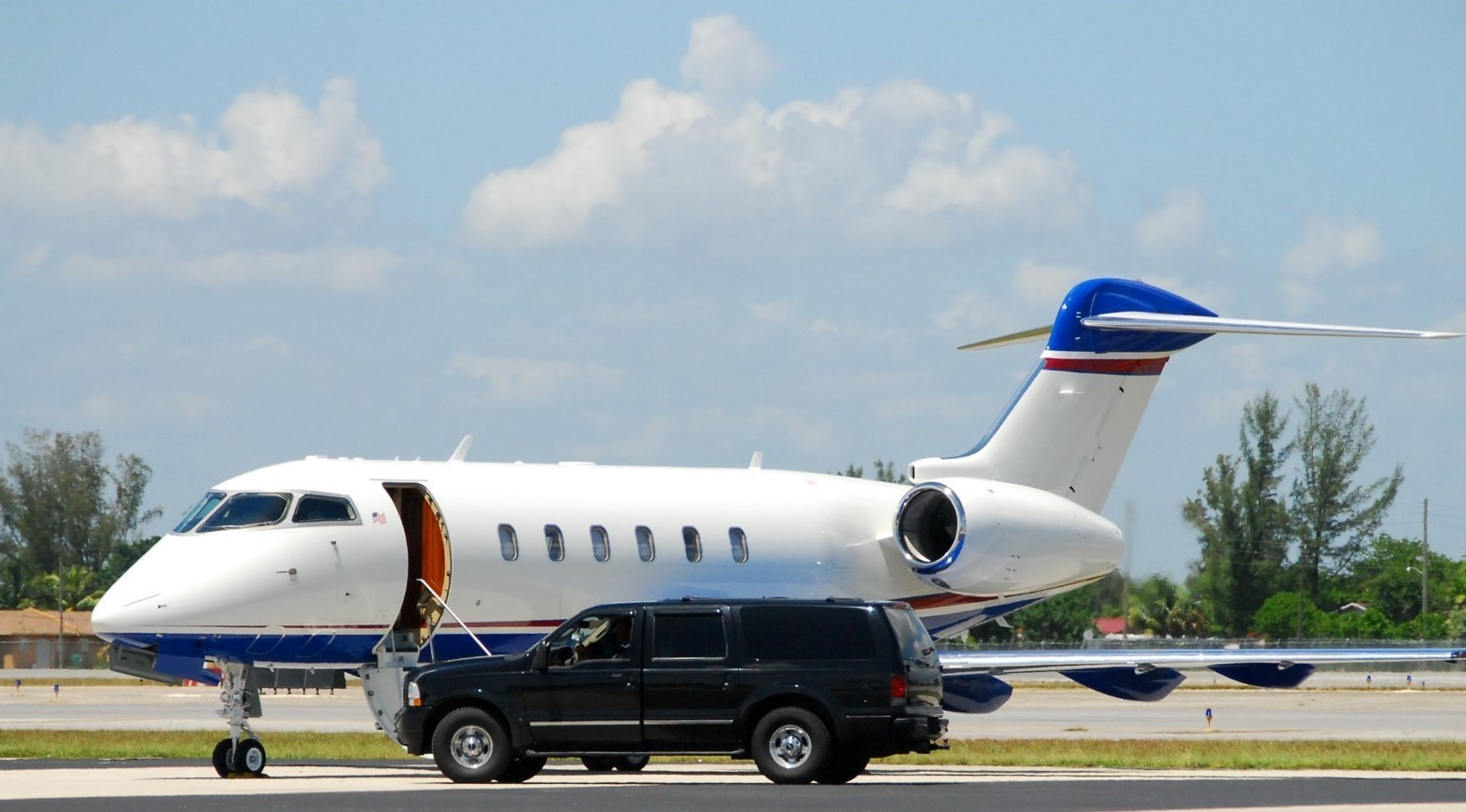 concierge services waiting in front of private jet